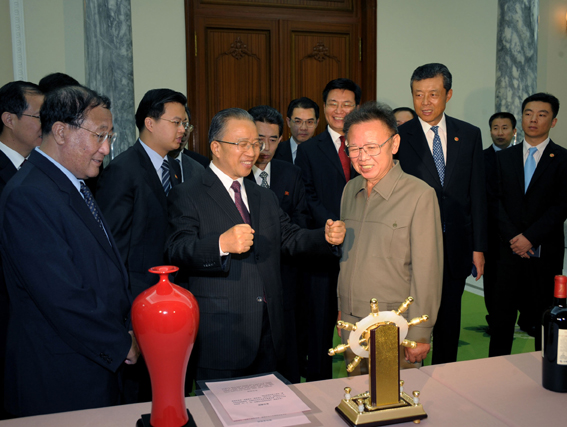 Senior Vice Minister of Foreign Affairs Kang Sok-ju (far left), Dai Bingguo and Kim Jong-il.  Photo: Korea Central News Agency