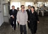 Kim Jong-il tours Huichon Silk Mill. (Photo: KCNA)