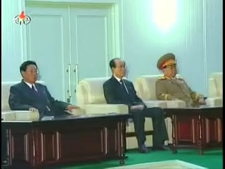 (From left to right) DPRK Premier Kim Yong-il, SPA Presidium President Kim Yong-nam and VMAR Kim Yong-chun, NDC Vice Chair and Minister of the People's Armed Forces watching the fireworks display. (Photo: KCTV)