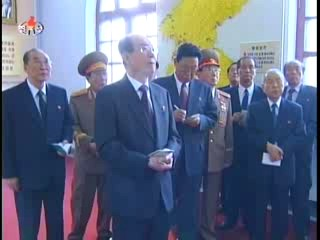 Kim Yong-nam and other State and Party heavyweights touring the Party Founding Museum. (Photo: KCTV)
