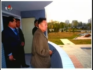 Kim Jong-il mounts his custom bird's eye view sans customized shades. (Photo: Korean Central News Agency)