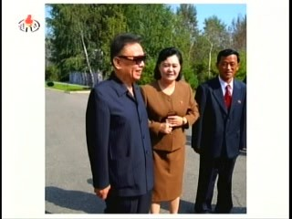 Kim Jong-il with the management of 7 December Factory (Photo: Korea Central TV)