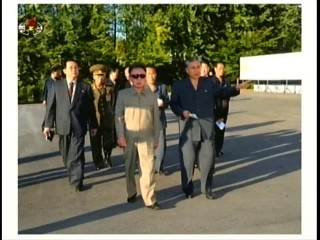 The pied piper of Pyongyang leading his travel party through the Ostrich Farm.  At the left is Jang Song-thaek wearing a western-style suit. (Photo: KCTV)