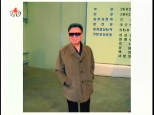 Christmas card photo?  Kim Jong-il grinning during his guidance tour of the Salmon Breeding Institute. (Photo: Korean Central News Agency)