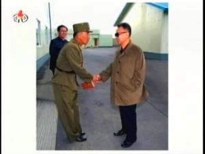 Kim Jong-il exchanges civilities with a manager of the Salmon Breeding Research Institute (Photo: Korean Central News Agency)