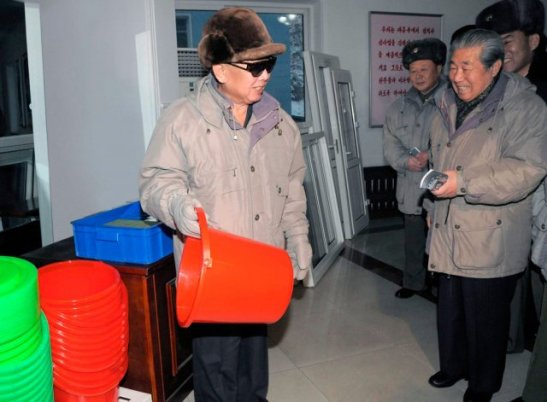 Kim Myong Guk (background, right) with KJI on a February 2010 guidance visit in Kangdong County, Pyongyang (Photo: NK Leadership Watch file photo).