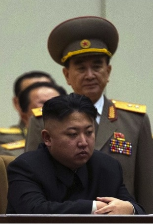 Kim Chang Son, with Kim Jong Un, at the 6th session of the 12th Supreme People's Assembly in September 2012 (Photo: KCNA)