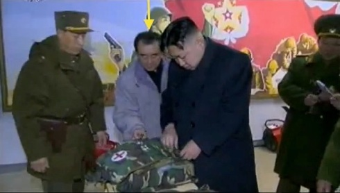 Kim Chang Son (annotated) assists Kim Jong Un's examination of first aid equipment during KJU's field inspection of KPA Unit #842 in February 2012 (Photo: KCTV screengrab/NKLW file photo).