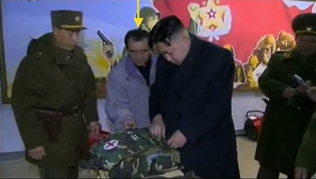 Kim Chang Son (annotated) assists Kim Jong Un's examination of first aid equipment during KJU's field inspection of KPA Unit #842 in February 2012 (Photo: KCTV screengrab)