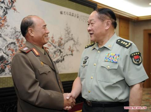 Col. Gen. Jon Chang Bok (L) shakes hands with former Chinese Defense Minister Liang Guanglie (R) in Beijing on 26 August 2011.  At the time Col. Jon was leading a KPA logistics delegation on a visit to China.  Jon was appointed 1st Vice Minister of the People's Armed Forces in May 2013. (Photo: Xinhua/Xie Huanchi)