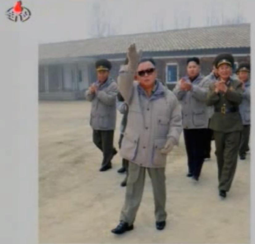 Col. Gen. Kim Yong Chol (R) accompanying KJI to a commemorative photo session during KJI's inspection of KPA Unit #322 (Photo: KCNA)