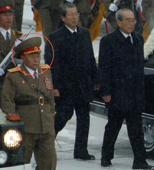 Gen. Kim Myo'ng-kuk (highlighted) clutches a radio while directing KPA officers and service members during KJI's funeral cortege on December 28, 2011 (Photo: NKLW/KCNA)