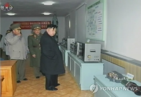Kim Jong Un (R) looks at equipment during his visit to the Strategic Rocket Force Command.  Also seen in attendance is VMar Ri Yong Ho (L). (Photo: KCNA-Yonhap)