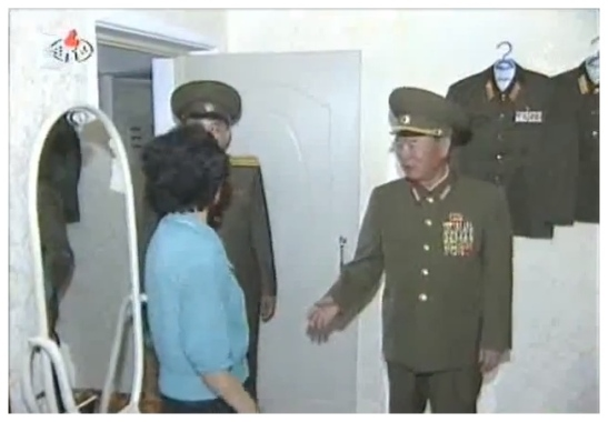 Gen. Ri Myong Su, Minister of People's Security and member of the National Defense Commission, meets a Changjon Street resident in her flat on 6 July 2012 (Photo: KCNA/KCTV still)