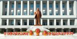 Floral baskets line the pedestal of a statue of late DPRK supreme leader Kim Jong Il at KPA Unit #10215, dedicated on 2 October 2012 (Photo: Rodong Sinmun)