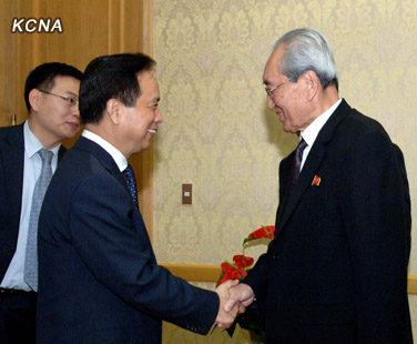 Li Jianguo (L) shakes hands with KWP Secretary Kim Ki Nam, prior to a meeting at Mansudae Assembly Hall on 29 November 2012 (Photo: KCNA)