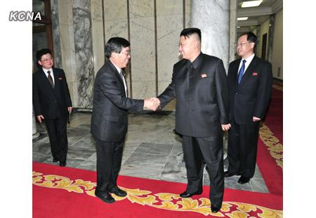 Kim Jong Un (R) shakes hands with PRC Ambassador to the DPRK Liu Hongcai (L) (Photo: KCNA)