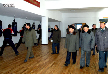 DPRK Premier Choe Yong  Rim (3rd R) looks at a boxing room at the Yanggakdo Sports Village (Photo: KCNA)