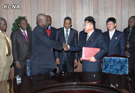 Nigerian Investment Promotion Commission Executive Secretary Mustapha Bello (L) shakes hands with Korea Foreign Investment and Economic Cooperation Vice Chairman Ri Sok Chol (R) after signing a memorandum of understanding in Pyongyang on 10 December 2012 (Photo: KCNA)