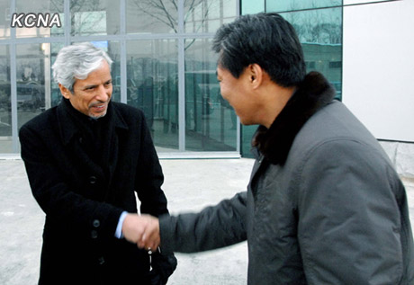 Hesham Al-Waqayan (L) Deputy Director of the Kuwait Fund for Arab Economic Development shakes hands with a DPRK official after arriving at Pyongyang Sunan Airport on 11 December 2012 (Photo: KCNA