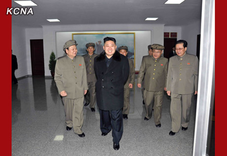 Kim Jong Un at the General Satellite Command and Control Center on 12 December 2012.  Also seen in attendance is KWP Secretary Pak To Chun (L) and NDC Vice Chairman Jang Song Taek (R) (Photo: KCNA)