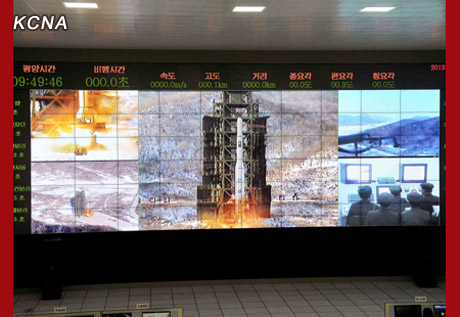 A view of monitors observing the U'nha-3's launch on 12 December 2012 (Photo: KCNA)