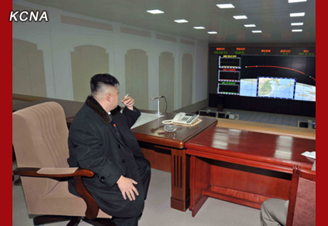 Kim Jong Un smokes a cigarette while watching the launch of the U'nha-3 on 12 December 2012 (Photo: KCNA)