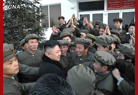 Kim Jong Un greets Korea Committee for Space Technology personnel prior to a commemorative photograph with them on 12 December 2012 (Photo: KCNA)