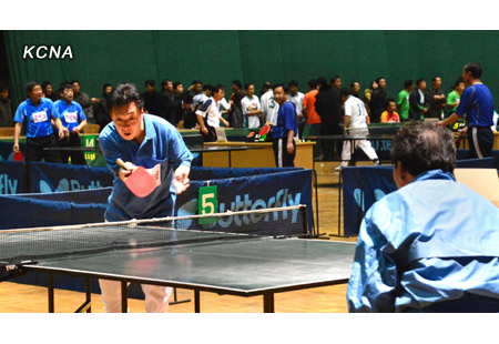 Table tennis play during a tournament for officials and employees of the party, government and economic institutions at Pyongyang Indoor Stadium on 19 December 2012 (Photo: KCNA)