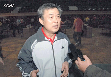 JVIC Chairman Ri Kwang Gun (Ri Kwang-ku'n) gives an interview with DPRK state media after participating in a table tennis tournament at Pyongyang Indoor Stadium in Pyongyang on 19 December 2012 (Photo: KCNA)