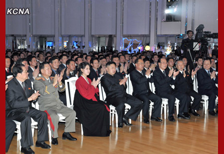 Kim Jong Un (4th L) and his wife Ri Sol Ju (3rd L) applaud during a performance by the Moranbong Band at a banquet celebrating the 12 December 2012 launch of the U'nha-3 rocket.  Also in this image are: Jang Song Taek (L), Choe Ryong Hae (2nd L), Choe Chun Sik (4th R), Kim Yong Nam (3rd R), Choe Yong Rim (2nd R) and Pak To Chun (R) (Photo: KCNA)