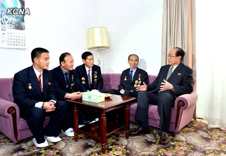 Kim Yong Nam (R) talkes with scientists, technicians and other personnel involved in the 12 December 2012 U'nha-3 rocket launch.  Kim was visiting the Pyongyang hotel where the launch personnel are staying.  (Photo: KCNA)