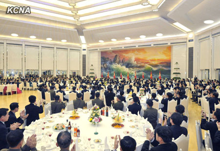 Overview of a 30 December 2012 banquet at Mokran House in central Pyongyang for personnel who contributed to the 12 December 2012 U'nha-3 rocket launch.  It was the second banquet hosted by the Korean Workers' Party Central Committee for those who participated in the launch.  As of 30 December 2012, launch participants had been staying in Pyongyang for two weeks (Photo: KCNA)