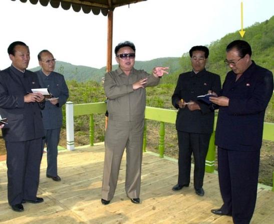 Ri Tae Nam takes notes during KJI's visit to a goat farm in Hamhu'ng, South Hamgyo'ng Province in May 2001 (Photo: Rodong Sinmun)