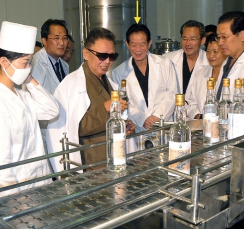 Ri Je Gang attends Kim Jong Il's visit to the Taedonggang Foodstuff Factory in September 2009 (Photo: Rodong Sinmun)