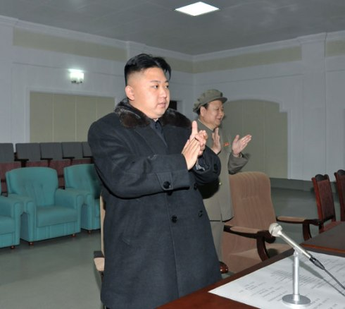 Kim Jong Un (L) applauds after the launch of the U'nha-3 during his visit to the General Satellite Command and Control Center in northern Pyongyang on 12 December 2012 (Photo: Rodong Sinmun)
