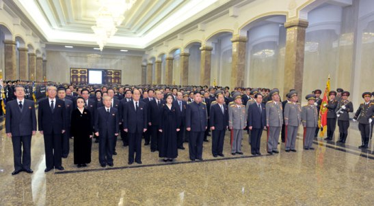 Kim Jong Un (7th L) and his wife Ri Sol Ju (6th L) pay their respects at Ku'msusan Memorial Palace on 17 December 2012.  Also seen in attendance are Choe Tae Bok (L), Kim Ki Nam (2nd L), Kim Kyong Hui (3rd L), Choe Yong Rim (4th L), Kim Yong Nam (5th L), Choe Ryong Hae (5th R), Jang Song Taek (4th R), Hyon Yong Chol (3rd R), Kim Kyok Sik (2nd R) and Kim Yong Chun (R) (Photo: Rodong Sinmun)