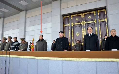 The mystery guest on the platform overlooking Ku'msusan Plaza at a ceremony opening the renovated Ku'msusan Memorial Palace on 17 December 2012.  Also in in attendance are Kim Kyok Sik (L), Hyon Yong Chol (2nd L), Jang Song Taek (3rd L), Choe Ryong Hae (4th L, speaking at a lectern) Kim Jong Un (3rd R) Kim Yong Nam (2nd R) and Choe Yong Rim (R) (Photo: Rodong Sinmun)