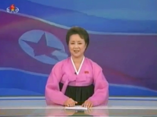 A Korean Central Television anchor finishes announcing the 12 December 2012 launch of the U'nha-3 (Photo: KCTV/KCNA screengrab)