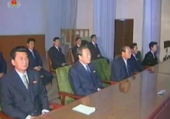 Ri Myong Gil (L), Ri Yong Su (2nd L) and Ko in Uk (3rd L) attending an agricultural workers' meeting on 12 December 2012 (Photo: KCNA/KCTV screengrab)