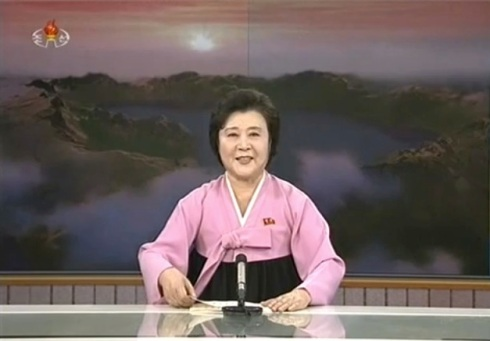 Korean Central Television news anchor Ri Chun Hui delivering the news bulletin reporting on KJU's visit to the GSCCC and observation of the launch of the U'nha-3 rocket on 12 December 2012 (Photo: KCNA/KCTV screengran)