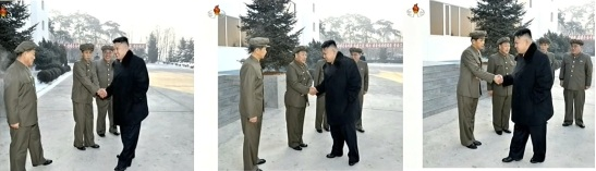 Kim Jong Un (R) greets KCST and KPA officials upon arriving at the General Satellite Control and Command Center in Pyongyang to observe the launch of the U'nha-3 and Kwangmyo'ngso'ng-3 satellite (Photo: KCNA/KCTV screengrab)