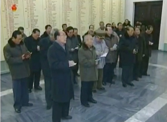 Members of the central leadership take notes during a  tour of the Ministry of the People's Armed Forces Revolutionary Museum on 23 December 2012 (Photo: KCTV screengrab)