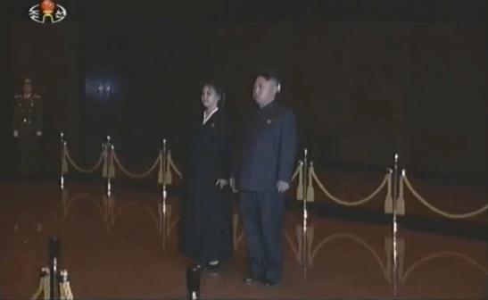 Kim Jong Un (R) and Ri Sol Ju (L) visit KJI's remains (Photo: KCTV/KCNA screengrab)