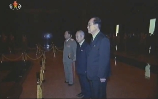Choe Ryong Hae (1st from the top), Choe Yong Rim (2nd from the top) and Kim Yong Nam (3rd from the top) pay their respects to KJI's body (Photo: KCTV/KCNA screengrabs)