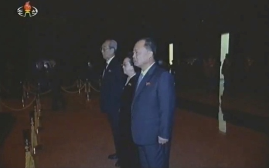 Kim Ki Nam (1st from the top), Kim Kyong Hui (2nd from the top) and Choe Chun Sik (3rd from the top) pay their respects to KJI's remains (Photo: KCTV/KCNA screengrab)