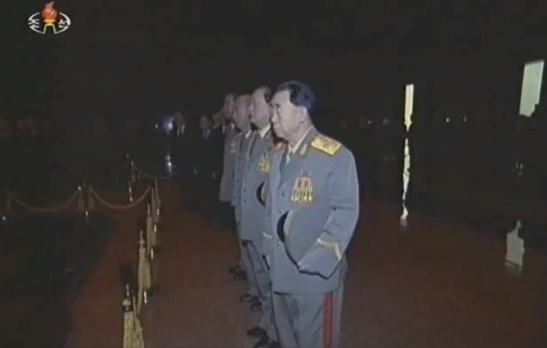 Hyon Chol Hae pays his respects to KJI's remains, along with senior security officials.  Also visible in this image is Gen. Kim Won Hong (Photo: KCTV/KCNA screengrab)