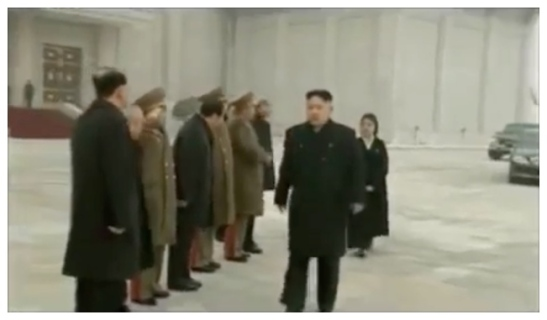 Kim Jong Un (foreground, R) greets members of the central leadership prior to a ceremony reopening the Ku'msusan Memorial Palace.  Also seen in attendance is his wife Ri Sol Ju (background, R) (Photo: KCTV/KCNA screengrab)