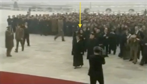 Aides assist members of the leadership, including Kim Kyong Hui (annotated), in removing their coats prior to entering the Ku'msusan Memorial Palace (Photo: KCTV/KCNA screengrab)