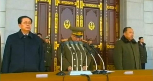 Choe Ryong Hae speaks during a ceremony inaugurating the renovation of Ku'msusan Memorial Palace.  Standing beside Choe are Jang Song Taek (L) and Choe Chun Sik (R) (Photo: KCNA/KCTV screengrab)